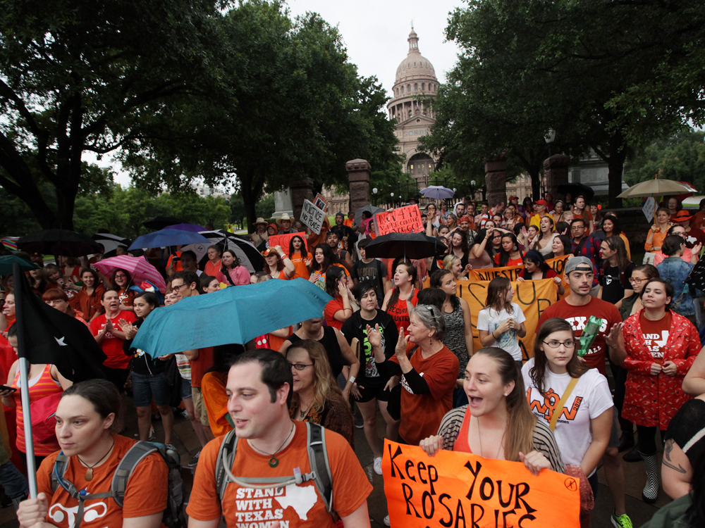 Abortion rights demonstrators rally outside of the Texas State Capitol, July 15, 2013