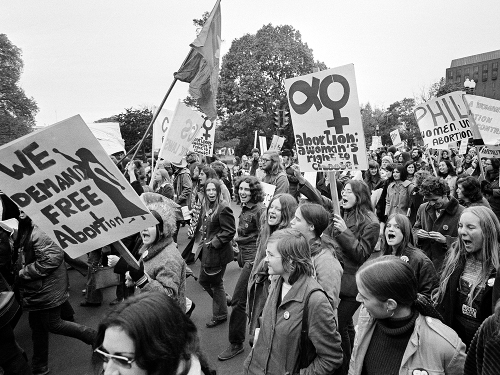 Demonstrators march to the U.S. Capitol for a rally seeking the repeal of all anti-abortion laws, Nov. 20, 1971